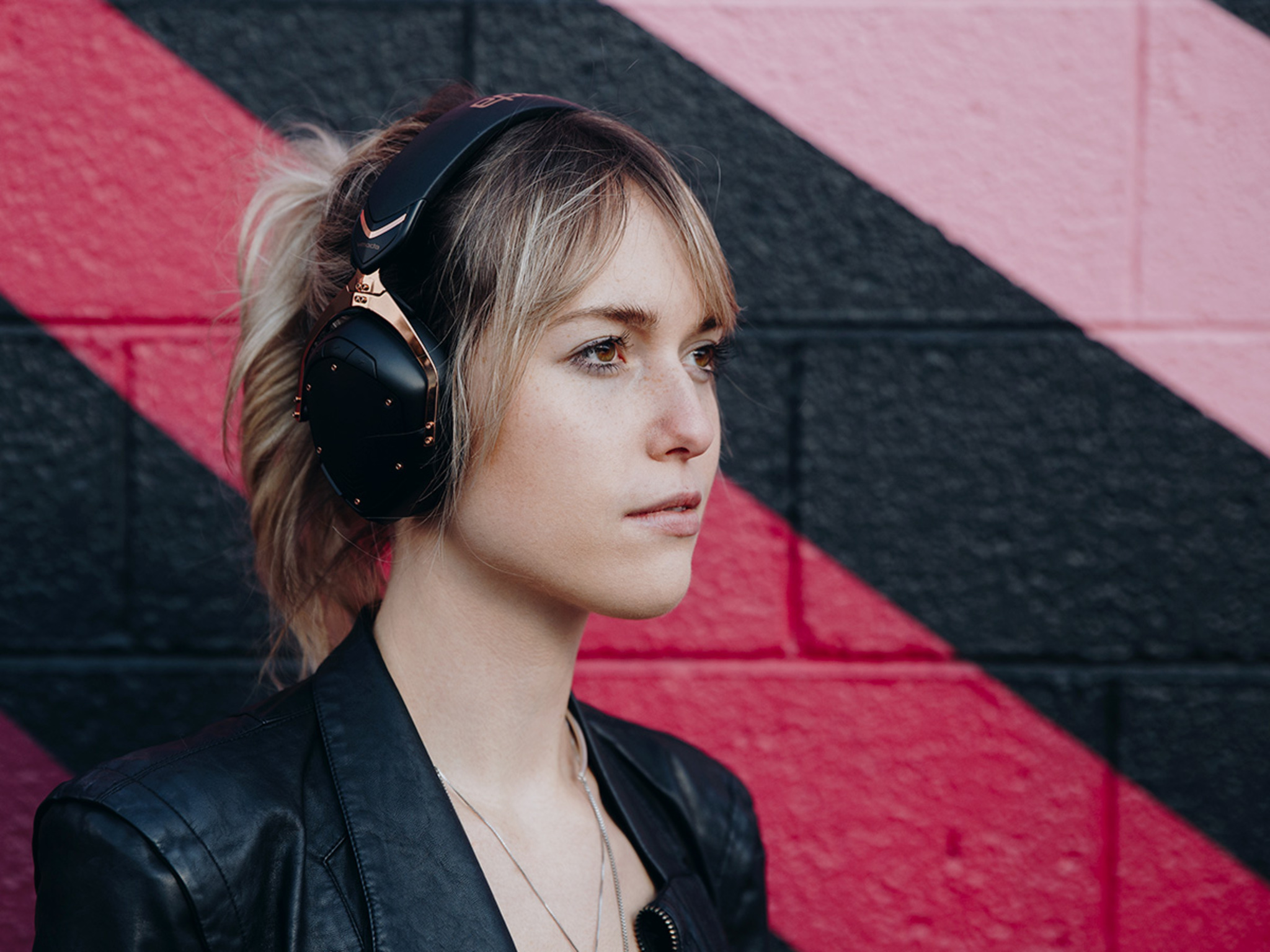 Girl wearing Crossfade 2 Wireless Codex Edition Over-Ear Bluetooth Headphones in Rose Gold
