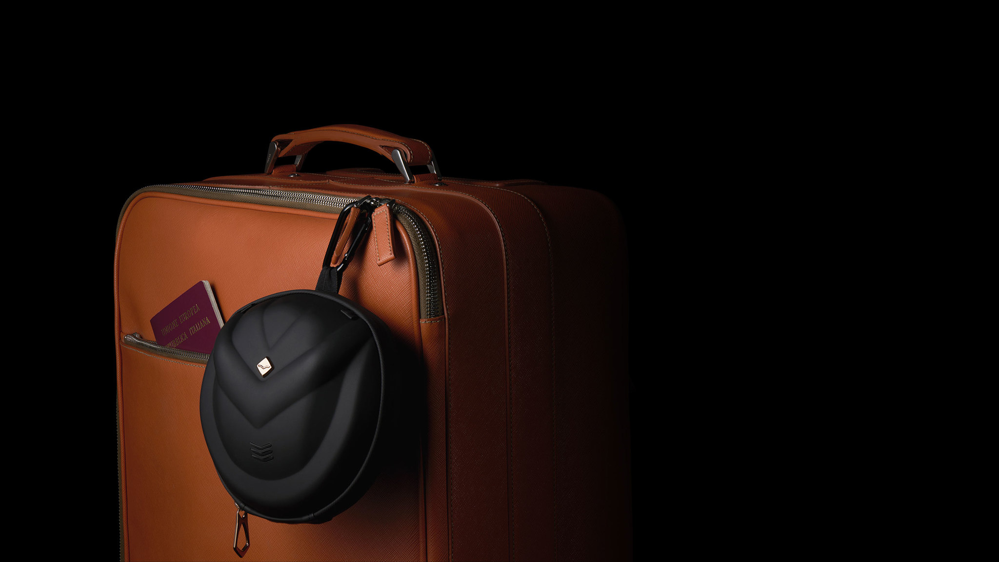 Crossfade 2 Wireless in its case and clipped to an orange suitcase